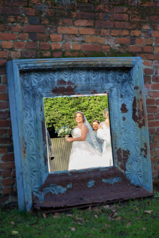 Bride in the mirror at Gaynes Park