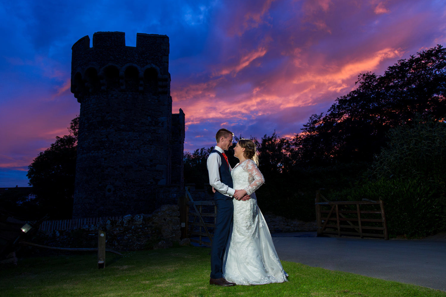Cooling Castle Barns bride and groom with sunset